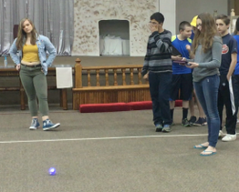 students testing their code on the sphero