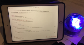 screen with code next to a sphero robot